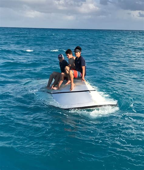 boat capsized teen boys rescued from capsized boat