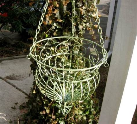 Iron Planters For Outdoors by Hanging Planter Basket Wrought Iron Antique Green