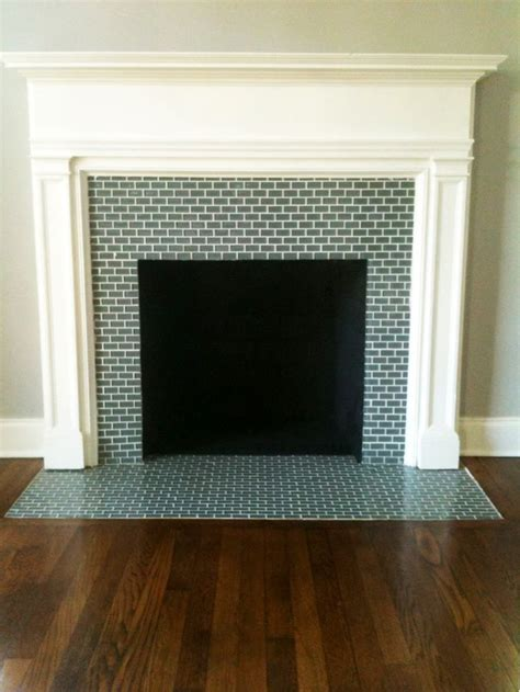 gray brick tile clad firebox surround and hearth