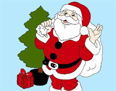 imagenes para dibujar a santa claus dibujo de santa claus y un regalo de navidad pintado por