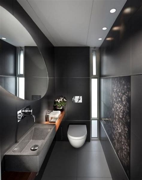 small bathroom with black wall color and rectangle sink