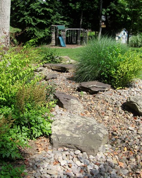 river rock garden bed gardens stormwater management and drainage solutions
