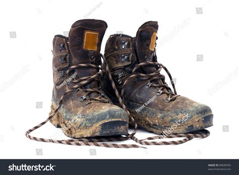 Kickers Trekking Boot Safety Steel Toe Outdoor Adventure hiking boots well worn muddy isolated stock photo 68838769