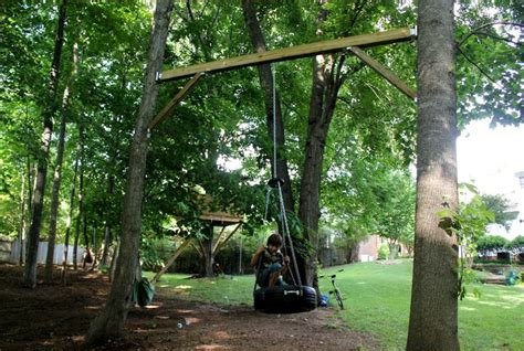 hanging a swing between two trees tire swing between two trees great idea if you don t