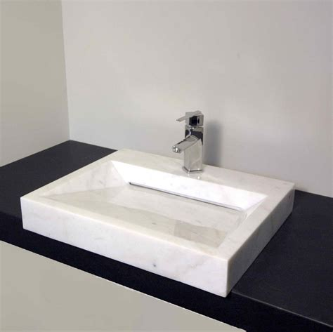 rectangular bathroom sink with two faucets tags