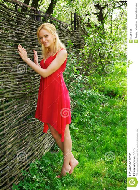 blonde bob red dress young beautiful blonde woman in a red dress royalty free