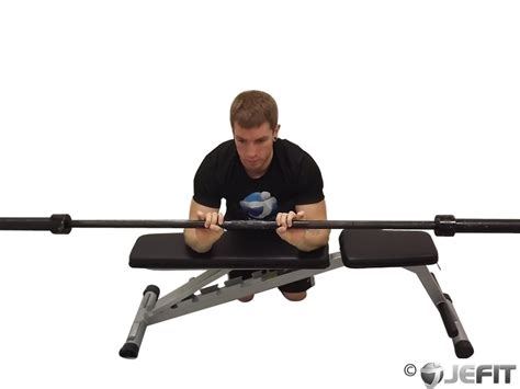reverse wrist curl over bench barbell palms down wrist curl over a bench exercise