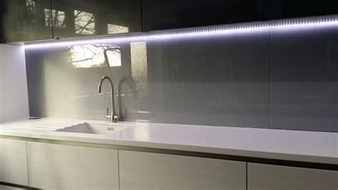 Contemporary Wood Kitchen Cabinets silver grey glass splashbacks