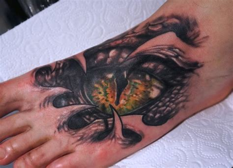 snake eyes tattoo on the foot by graynd tattooimages biz