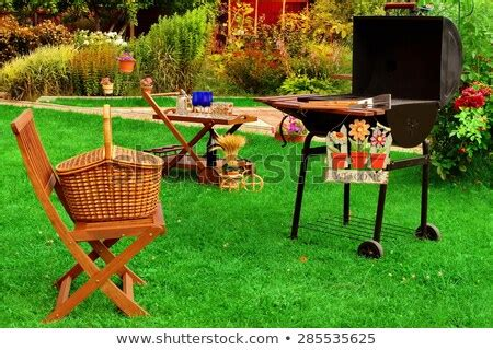 garden wooden furniture picnic hamper basket stock photo