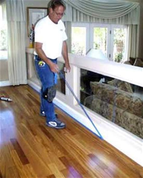 how to install wood floor without removing baseboards caulk gaps bottom of baseboards without the mess