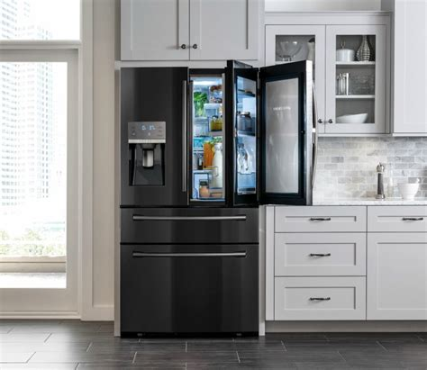 black kitchen cabinets with stainless steel appliances bringing back to the kitchen samsung s black stainless steel appliances mafia