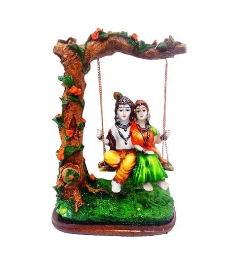 Radha Krishna Swing karigaari polyresine multicolor radha krishna on swing by kariggari idols