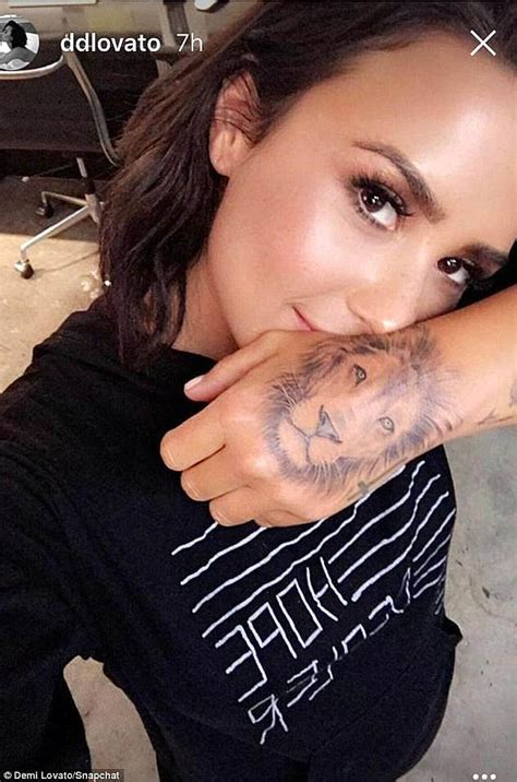 justin bieber lion tattoo demi lovato displays faded lion tattoo at the amas daily