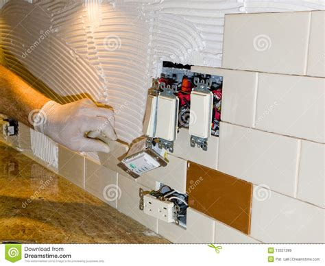 installing tile backsplash kitchen ceramic tile installation on kitchen backsplash 10 royalty free stock images image 13321289