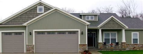 green siding house scottish thistle light green sidign cream trim faux cedar shakes carlson exteriors