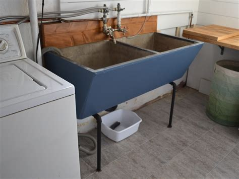 for basement sink favored custom concrete laundry sink with black metal base
