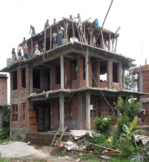 building a house file building a house nearby the street between kathmandu