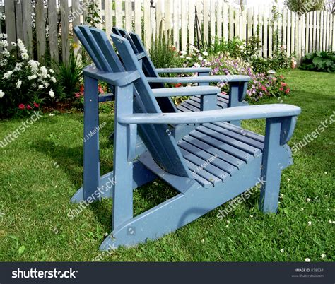 Blue Sitting Chairs Blue Wooden Garden Chairs Sitting On The Lawn Stock Photo