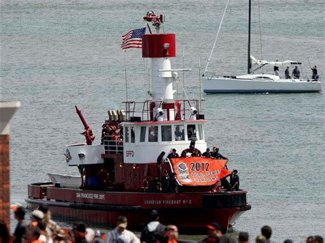 tug boat flags the san francisco fire department brings in the giants