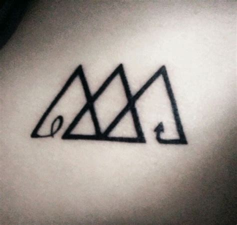past and future tattoos the three triangles represent the past present and