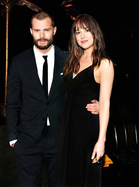 dakota johnson and jamie dornan huddle up for fifty shades 16042 best fifty shades of grey trilogy images on