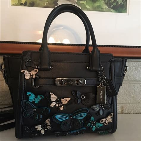 Coach Swagger Black Flower 44 coach handbags sale coach butterfly appliqu 233 swagger 21 firm from jodi suggested