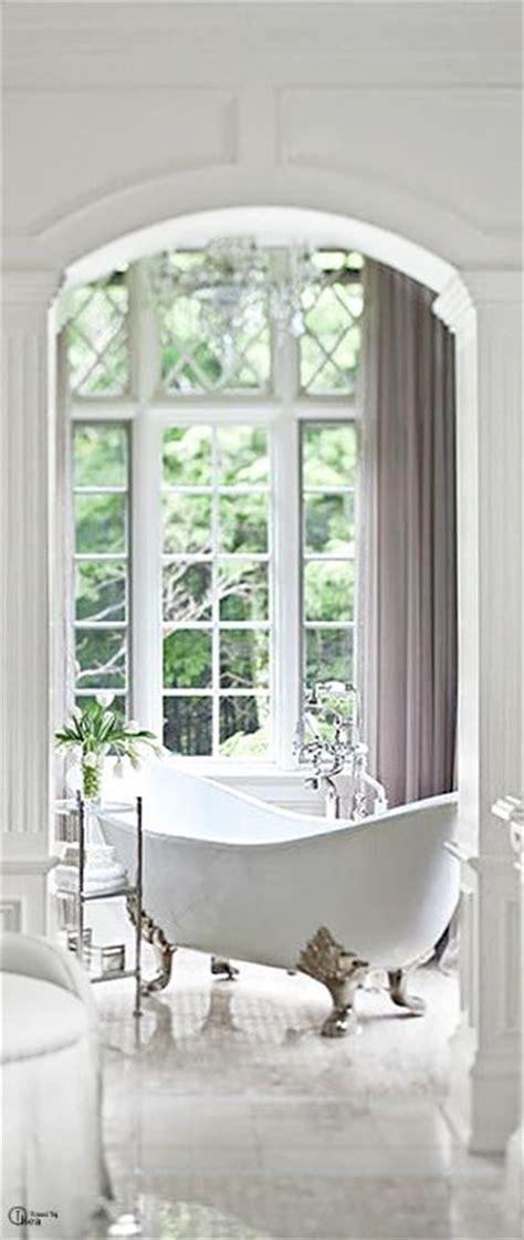 french bathroom decor white bathroom window bright light claw foot tub