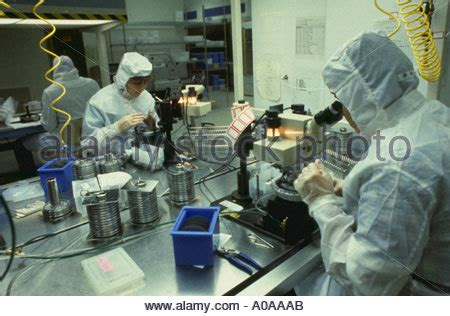 computer clean room electronics workers in clean room assembling electronic components stock photo royalty free