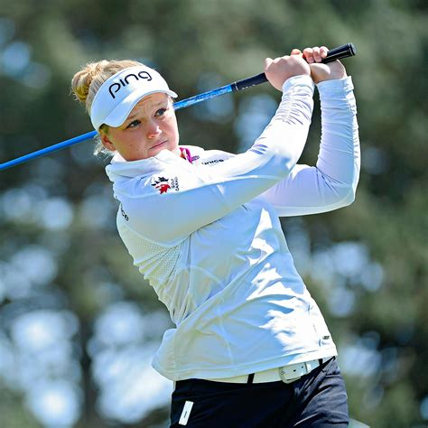 swinging skirts golf leaderboard tour hopeful 17 year old brooke henderson leads by one at
