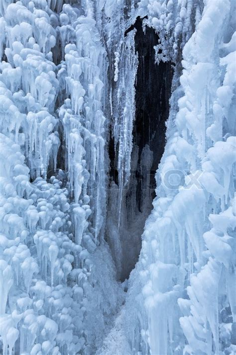 image of beautiful icicles from frozen waterfall stock