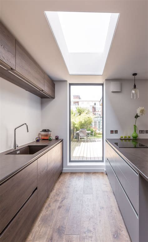 window on ceiling modern kitchen extension sleek design framed garden