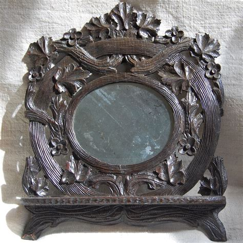 antique black forest mirror with folding shelf from