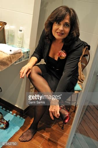 mature bathtub mature woman taking off high heels in bathroom stock photo getty images