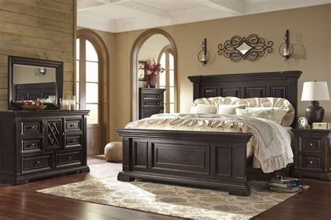 willenburg casual dark brown solid wood master bedroom set