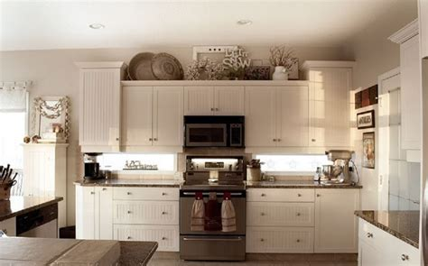 decorating ideas kitchen cabinet tops ideas for decorating the top of kitchen cabinets