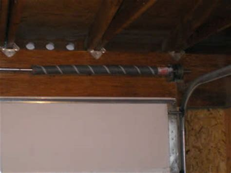 Fixing Garage Door Torsion Springs Do It Yourself Or Not Tightening Garage Door Springs