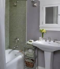 wonderful bathroom with grey wall and green tiles on tub