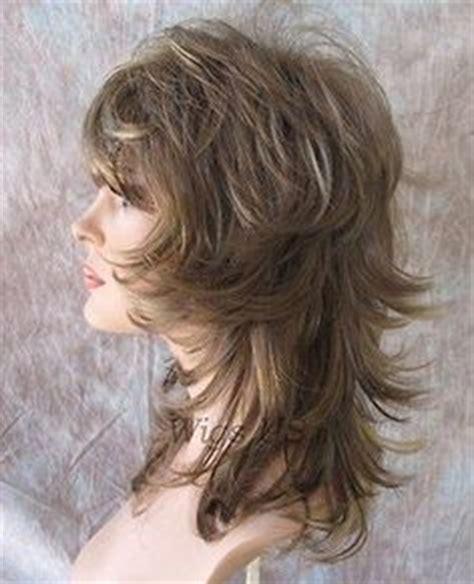 pics long choppy layered hairstyles with bangs wigs long wig choppy layers lots of motion auburn ginger and
