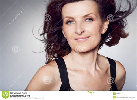 frizzy aged hair happy middle aged woman with curly hair stock photos