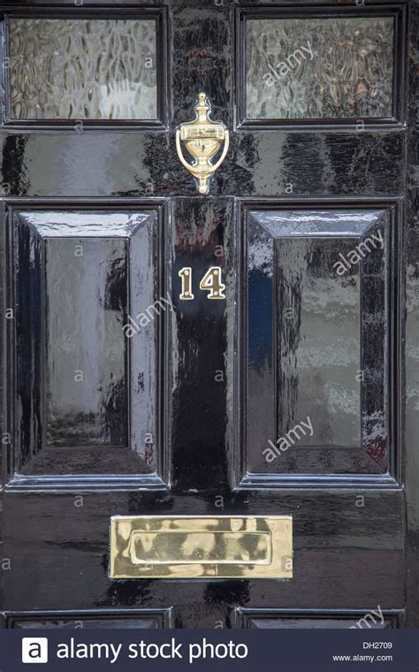Front Door Detail Of Traditional English House With Brass Letter Boxes For Front Doors