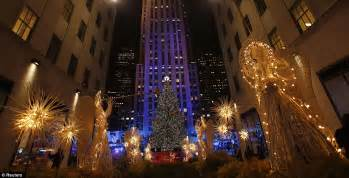 rockefeller center christmas lights turned on with help