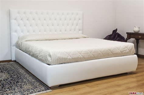white bed leather double bed with upholstered and buttoned headboard