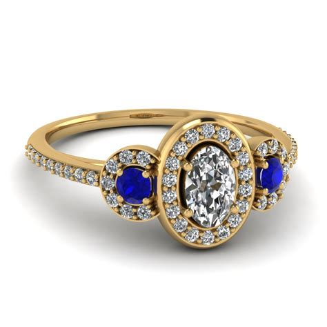 18k yellow gold oval shaped blue sapphire halo engagement