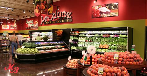 produce section supermarket choosing a grocery store market basket