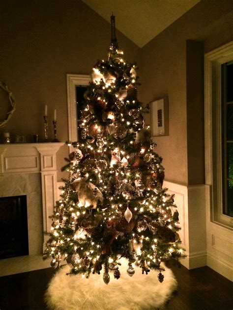 a pottery barn christmas tree with all the trimmings