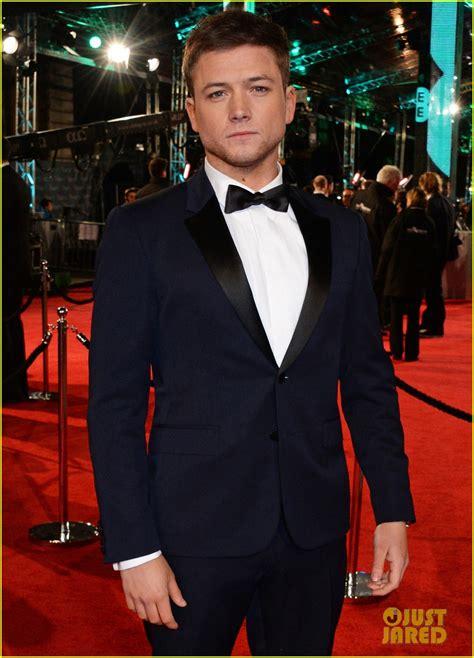 taron egerton engaged taron egerton rocks his finest suit for baftas 2016