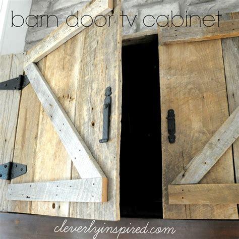 barn door tv wall cabinet barn door tv cabinet above mantle cleverly inspired