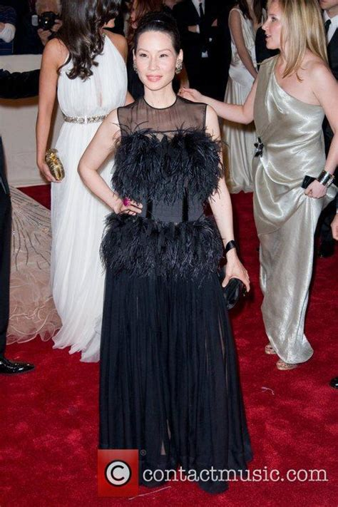 Lucky Liu At The Met Costume Gala With Zac Posen And 35 Carats Of Yellow Sapphires To Left by Liu Mcqueen Savage Costume