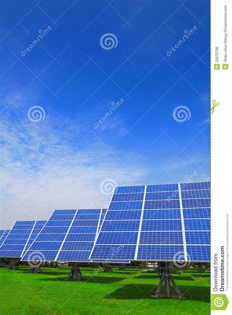 solar panel with green grass and blue sky royalty free